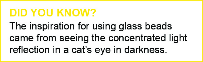 "Text Graphic: ""Did You Know? The inspiration for using glass beads came from seeing the concentrated light reflection in a cat's eye in darkness."""