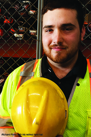 Flagger Force employee, Richard Florio, with his retired hard hat.
