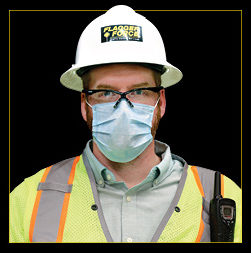 Justin Zellers headshot—wearing his PPE and a mask